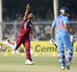 Rampaul dismisses Rohit Sharma