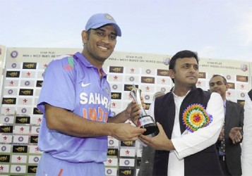 Mahendra Singh Dhoni, captain of India receives the Star Sports trophy during the presentation after the third Star Sports One Day International (ODI) match between India and The West Indies held at the Green park Cricket Stadium, Kanpur, India yesterday. BCCI