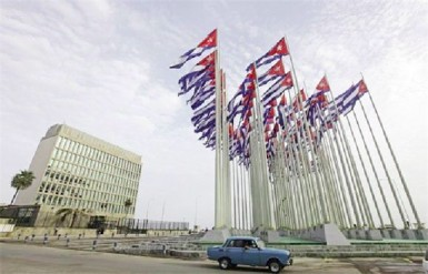 A car drives past the building of the US diplomatic mission in Cuba, the US Interests Section, (USINT), in Havana, in this September 12, 2013 file picture. (Reuters/Desmond Boylan/Files)
