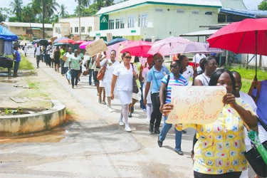 Linden public servants along Republic Avenue during a march organised yesterday to protest against the 5% public servant wage increase.