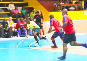 Hikers striker Aroydy Branford (left) on the attack against YMCA of Barbados