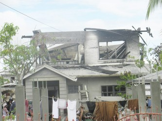 The damaged house after Thursday's fire