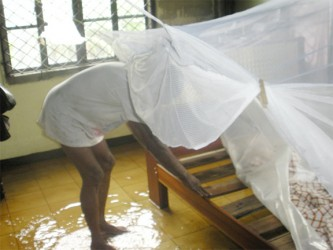 Clarence Scott's shows his make-shift bed in the flooded bottom flat of his Sophia home