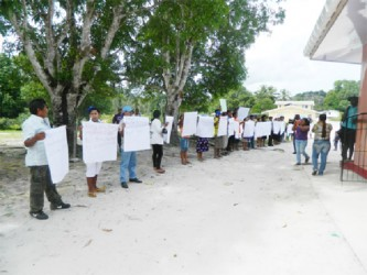 """Isseneru villagers protesting the visit by a team from the National Toshao's Council which they said failed to meet with them on their concerns despite being invited to a meeting. Villagers said that they question the sincerity of the NTC in representing them after a team showed up on a """"fact-finding mission"""" to see if what the petition said was true."""