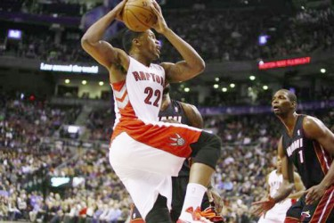 Toronto, Ontario, CAN; Toronto Raptors forward Rudy Gay (22) goes up to shoot as Miami Heat center-forward Chris Bosh (1) looks on at the Air Canada Centre. Miami defeated Toronto 90-83. (John E. Sokolowski-USA TODAY Sports)