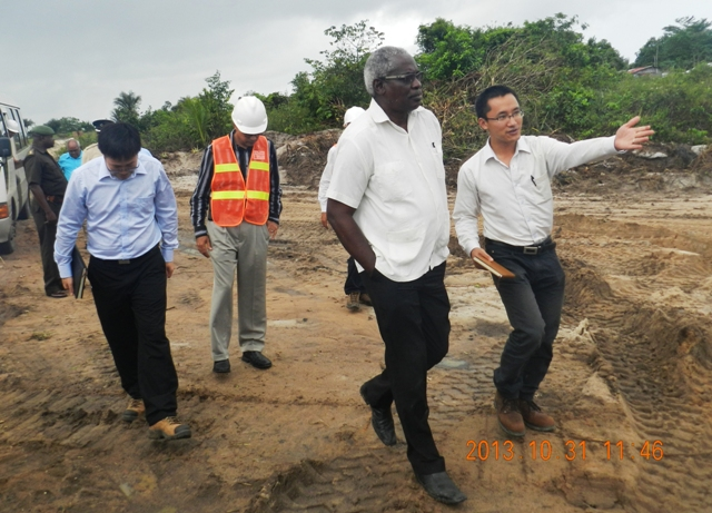 Works Minister Robeson Benn (second from right) touring the site. (CJIAC photo)