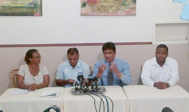 Charrandass Persaud (second from right) sits among his colleagues on Friday