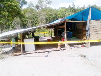 The camp that Molly James and her children called home. The zinc sheets were only put on yesterday, according to a relative. (Photo by Oluatoyin Alleyne)