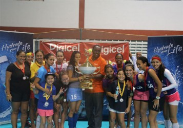 Women's champions GCC Tigers posing with their championship trophy with Digicel Event Manger Gavin Hope (centre) following their victory over Malvern of Trinidad and Tobago