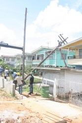 GPL workers trying to remove the fallen pole. (Photo by Arian Browne)