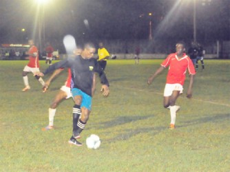 Mahaica Determinators Azuma Roberts (in black) trying to keep possession against Riddim Squad defender Linden Pickets (behind) during their sides' bruising matchup