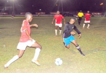 Riddim Squad's Teon Jones (left) challenging Mahaica Determinators Azuma Roberts (right) for possession of the ball
