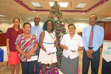 (L to R) Floret Ramsaran, Senior Manager of GBTI's I.T. Department; Norma Hamilton, administrator of Uncle Eddie's home; Sean Noel, Manager of Administration at GBTI; Marcelle George of the David Rose School for Handicapped Children; Laura Yangil Augusto of the Salvation Army, and John Barnes, Senior Manager of GBTI's Risk Department at yesterday's donation ceremony.
