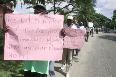 Former GTC and GT&T workers demonstrating in front of the Office of the President yesterday (Photo by Arian Browne)