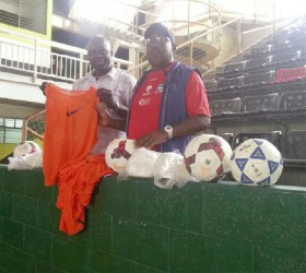 Former head coach of the Golden Jaguars, Jamal Shabazz (right) presenting a quantity of bibs and game balls to co-founder of the Kashif and Shanghai (K&S) Organization, Aubrey 'Shanghai' Major yesterday in Trinidad.