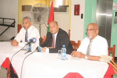 Chairman of Laparkan Glen Khan (centre) Chief Executive Officer of Laparkan, Hussein Haniff (left) and press conference moderator Ron Robinson yesterday.