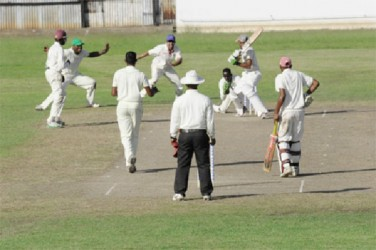 At the Enmore Community Centre ground, batsman Rovindra Parsram is caught behind off the bowling of spinner Amir Khan