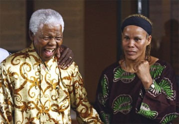 Guyana's first female world boxing champion, Gwendolyn 'Stealth Bomber' O'Neil stands with Nelson Mandela during the promotion of her 2007 title fight versus Laila Ali.