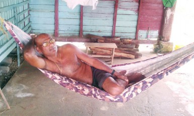 Deonarine Ramnarine reclining in his hammock