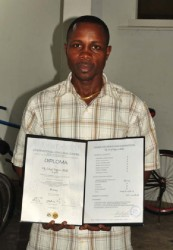 Sebert Blake with his International Coaching Course Diploma in hand. (Orlando Charles photo)