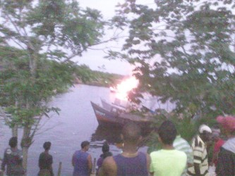 The burning boat can be seen in the foreground