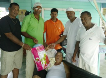 Members of the BLUCC delivering items to one of the shut-ins