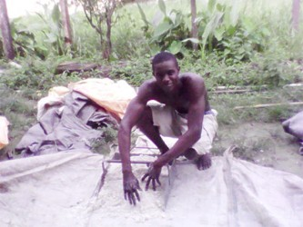 Jason George preparing fertilizer for the rice crop
