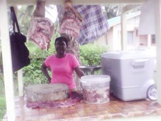 Cryselene David  selling salted and fresh pork