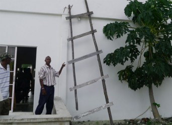 The ladder used to enter the house