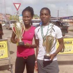 Alika Morgan and Kelvin( Johnson posing with their spoils after Sunday's Bigi Broki Waka 10km road race which was staged Paramaribo, Suriname.
