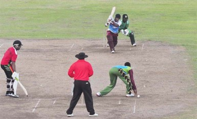 Leon Johnson driving one back past the bowler during his match-winning half-century knock. (Orlando Charles photo)