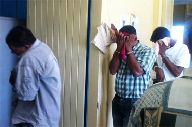 The accused: Doodnauth Sieuchand, Karran Ramit  and Premnauth Seepersaud  leaving court yesterday.