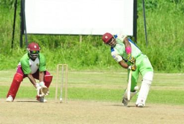 Christopher Barnwell smashes a delivery through midwicket during his topscore of 84. (Orlando Charles photo)