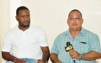 President of the GAPF, Peter Green speaking at yesterday's media briefing as PRO of the federation, Denroy Livan looks on. (Orlando Charles photo)