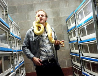Jeremy Stone of Lindon, Utah, was photographed with an albino boa constrictor for a profile that ran in the New York Times in 2011. (Djamila Grossman/New York Times photo)