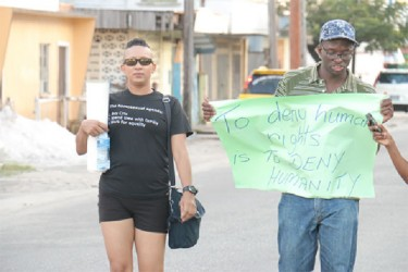Co-chairperson of the Society Against Sexual Orientation Discrimination (SASOD), Joel Simpson (right) and secretary Zenita Nicholson during the walk in memory of Wesley Holder..