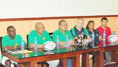 Regional Development Officer (RDO) of North America Caribbean Rugby Association (NACRA), Scott Harland makes a point at yesterday's media briefing as executive members of the GRFU look on. (Orlando Charles photo)