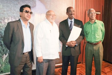 New Ombudsman, retired judge Winston Moore (second right) poses with from right Opposition Leader David Granger, President Donald Ramotar and Attorney General Anil Nandlall. (Arian Browne photo).