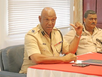 'A' Division Commander George Vyphuis (left) responding to a question from a reporter during yesterday's press conference.