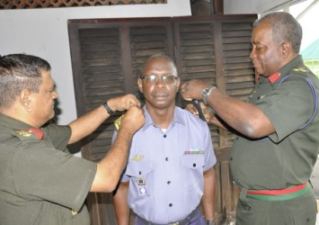 The Chief of Staff affixes acting Commander (CG) Orin Porter's new badge of rank. He is assisted by the Deputy Chief of Staff Colonel Kemraj Persaud. (GDF photo)