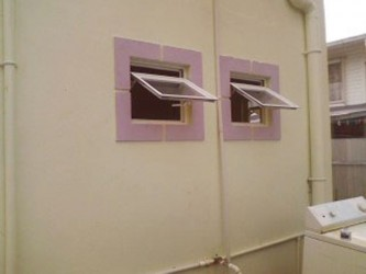 The bathroom window through which the intruder entered
