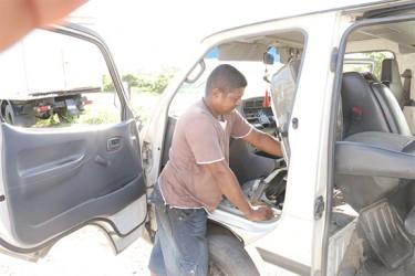 Rickey repairing a bus
