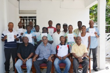 AIBA certified referee/judge, James Beckles (second from right seated) poses with participants of the referee and coaching workshop which concluded yesterday at the GOA building. He is also flanked by executive members of the GBA and Director of Sport Neil Kumar.