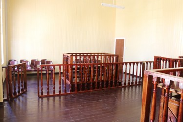 The interior of a section of Court 11: It shows a section of the well of the court, the prisoners' dock and the seating area in the public gallery. (Photo by Arian Browne)