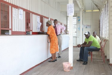 Customers conducting business at the Kitty Post Office yesterday.