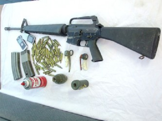 The rifle and the magazines along with the grenades that were recovered yesterday by police from the teens. (Guyana Police Force photo)