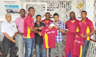 National skipper Christopher Barnwell receives a club T-shirt from the sponsors, while DCC President Alfred Mentore (second from left) and other players look on.