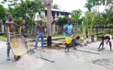 Residents constructing a bridge