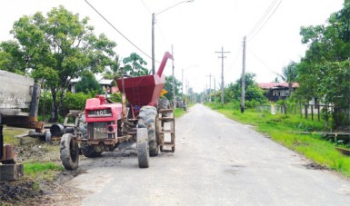 A tractor parked along the roadway