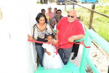 President Donald Ramotar (right) during the cutting of the ribbon to launch one of the expanded core homes at La Parfaite Harmonie (GINA photo)